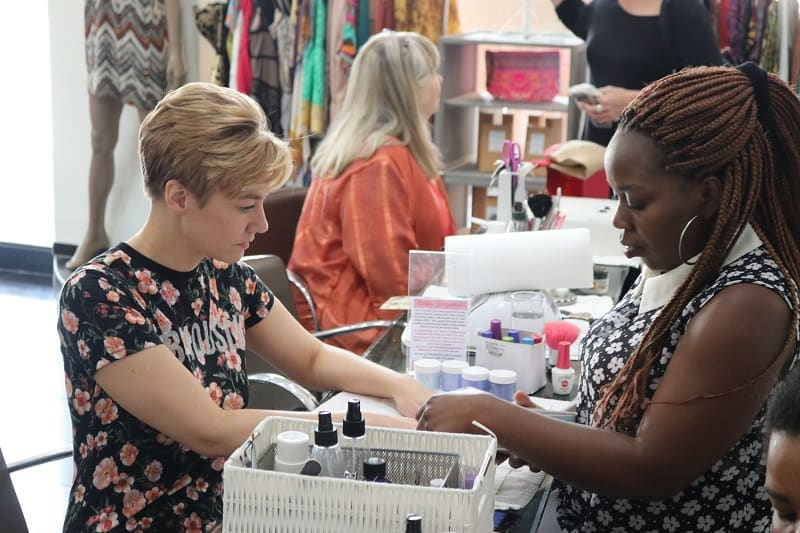 Getting manicure at Fashion Squared