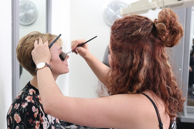 Makeup being done at Fashion Squared