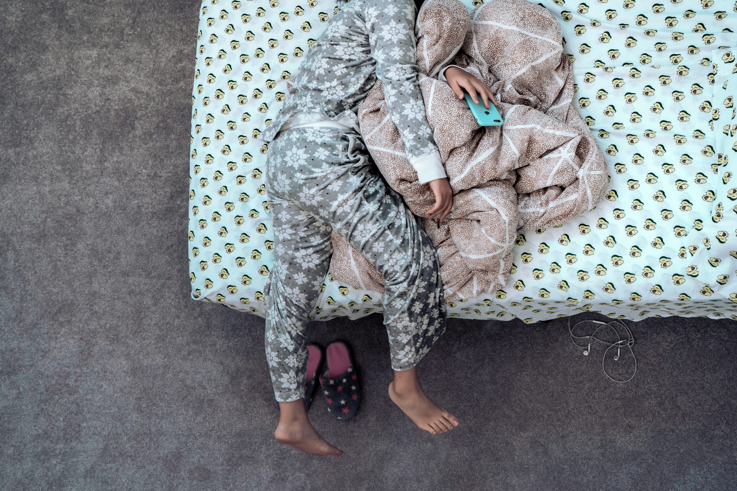 Woman in pyjamas on bed